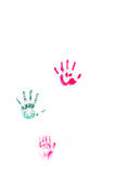 Children's hand prints on white wall. Different children's hand prints on white wall stock photos
