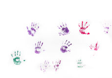 Children's hand prints on white wall. Different children's hand prints on white wall stock images
