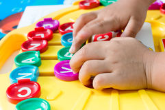 Children's Hand  to play alphabet games, Selective focus to Alphabet Royalty Free Stock Photography