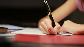 Children`s hand writes a pen on paper stock video footage
