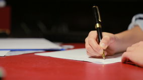 Children`s hand writes a pen on paper stock footage