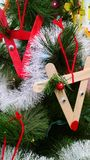 Children's handmade Christmas ornaments. Handmade Rudolf's made out of craft sticks by preschool students Royalty Free Stock Photos
