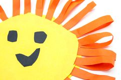 Children`s handmade from colored paper - the sun with a smile. Isolated on white background Stock Photography