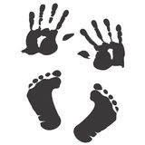 Children`s handprint and footprint Royalty Free Stock Image