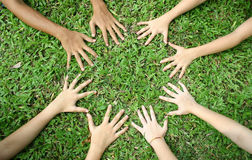Children's hands. A circle of children's hand on the ground Royalty Free Stock Photos