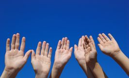 Children's Hands. A group of children lift their hands in the air Royalty Free Stock Images
