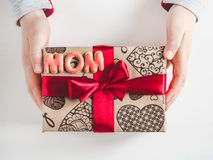Children`s hands, beautiful box with a gift royalty free stock photo