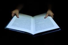 Children`s hands a book Stock Image