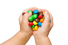 Children's hands with candy Royalty Free Stock Photos