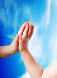 Children's hands close-up on the sky Royalty Free Stock Image
