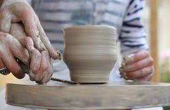 Children's hands creating new vase. Children Potter's hands creating new vase Stock Photography