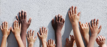 Children`s hands. Crowd of children`s hands leaning at the wall royalty free stock photo