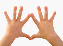 Children's hands depict. Shape isolated on white royalty free stock image