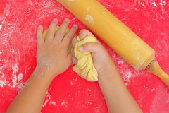 Children`s hands in flour and dough stock photo