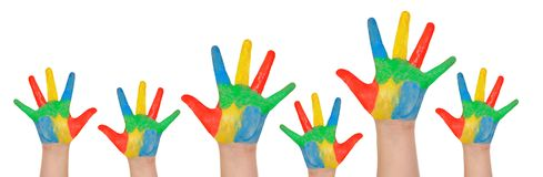 Children`s hands full of paint Stock Image