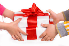 Children's hands with gift boxes Royalty Free Stock Image