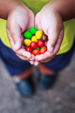 Children's hands holding candy Stock Image