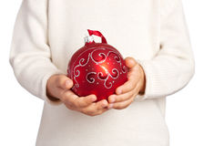 Children's hands holding Christmas ball Stock Photos