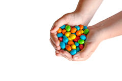 Children's hands holding colorful candy. Stock Images