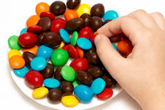 Children's hands holding colour caramel Royalty Free Stock Photography