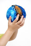 Children's hands holding globe Stock Images