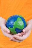 Children's hands holding a globe Stock Photo