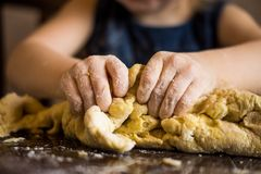 Children's hands knead the dough royalty free stock photography