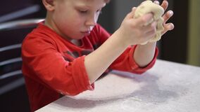 Children`s hands knead a thin dough for pizza. Children`s hands knead a thin dough for pizza stock footage