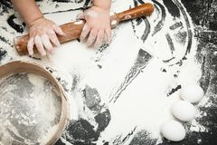 Children`s hands learn to make dessert, playing with flour stock images