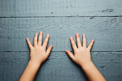Children's hands is located on an wooden plate Stock Image
