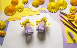 Children`s hands make a princess of paper. Handy for a party. A gift for the Mother`s Day holiday. Master Class. Kindergarten. Materials for creativity stock photography