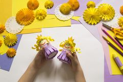 Children`s hands make a princess of paper. Handy for a party. A gift for the Mother`s Day holiday. Master Class. Kindergarten. Materials for creativity stock photos