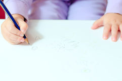 Children's hands painted with a pencil. Royalty Free Stock Images