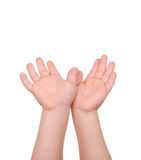 Children's hands palms upwards on white Stock Image