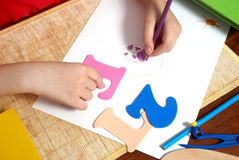 Children's hands papers drawing Royalty Free Stock Photos