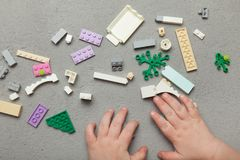 Children`s hands played with colorful wooden bricks.  stock images