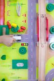 Children`s hands playing wooden toy train stock images