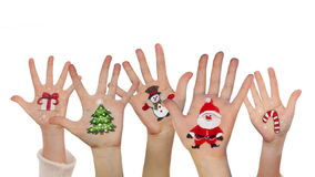 Children's hands raising up with painted Christmas symbols stock video footage