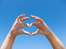 Children's hands showing sign of heart Royalty Free Stock Photos