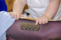 Children's hands in a suitcase. Children's hands in suitcase, a journey. A small child got out of suitcas and exploring the castle, the concept of security Royalty Free Stock Image