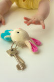 Children's hands to reach for a sheaf a key. With a soft toy a hare Royalty Free Stock Image