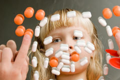 Children's Health. Reflection in the mirror girl with pills Royalty Free Stock Image