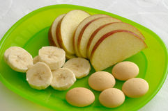Children's Healthy Meal. Consisting of apples, bananas and biscuits Royalty Free Stock Photo
