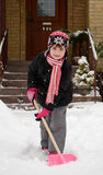Children's help with winter cleaning Royalty Free Stock Photo