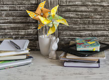 Children's home workspace with books, notebooks, notepads, tablet and handmade paper pinwheels Stock Photography