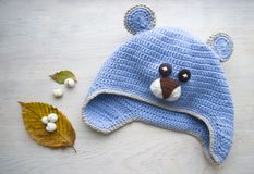 Children`s hooked hat handmade in the form of a bear.  Stock Photo
