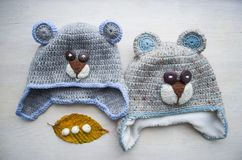 Children`s hooked hat handmade in the form of a bear.  Royalty Free Stock Image
