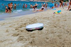 A children`s inflatable circle for swimming lies on the sand on the beach.  Royalty Free Stock Photo