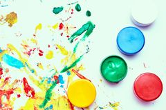 Children`s ink for drawing on a white background, finger paints, hand prints. A child draws. a child`s drawing inks, finger paints, hand prints royalty free stock photo