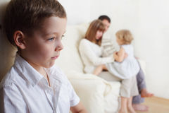 Children's jealousy. Boy is jealous parents of younger sister Stock Photos